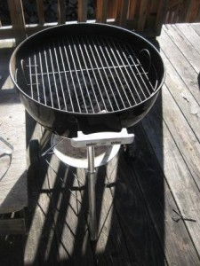 Charcoal Grilling on a Wooden Deck