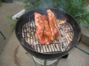 Ribs just placed in the rack on the hot grill